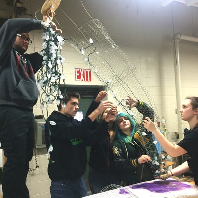 Howell High School art students, from left, Michael