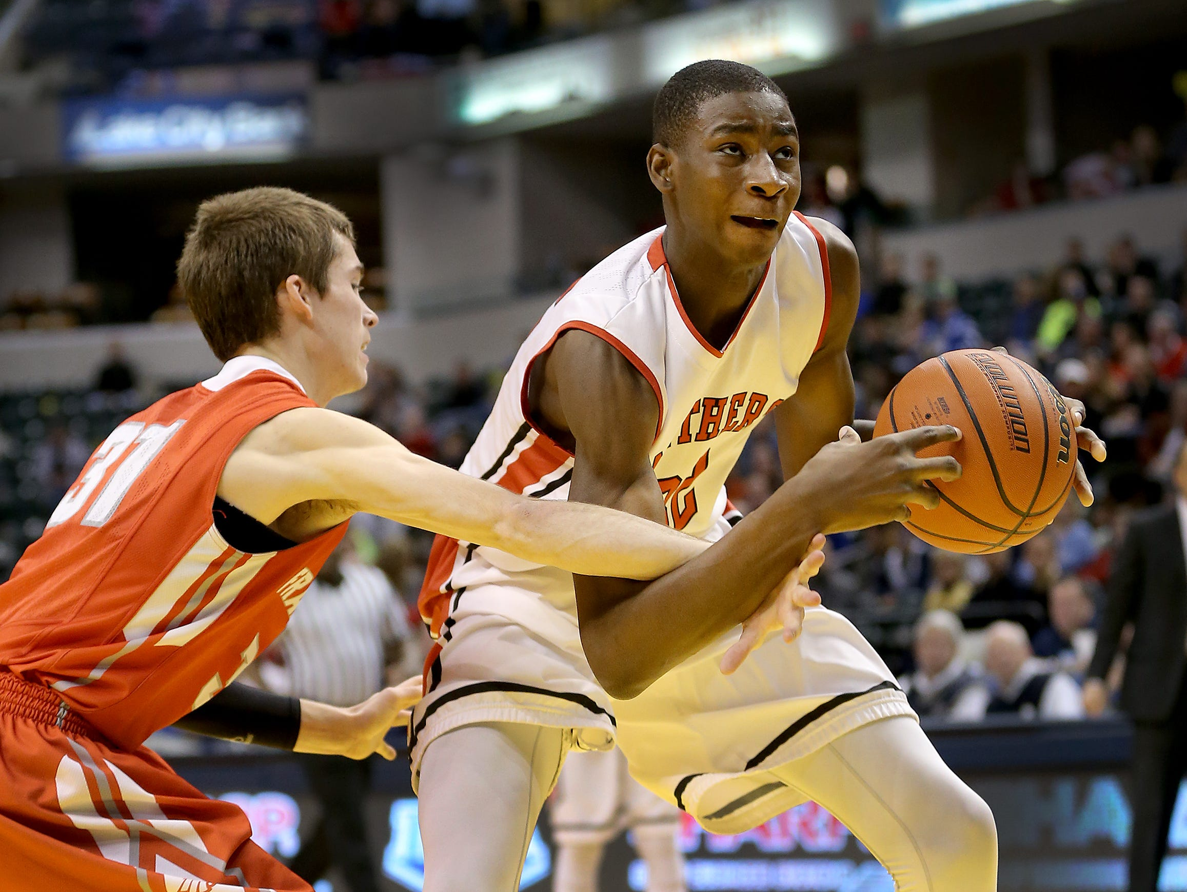 Park Tudor's Jaren Jackson Jr., is fouled by Frankton's Austin Compton during the ISHAA 2A State Championship game March 28, 2015.