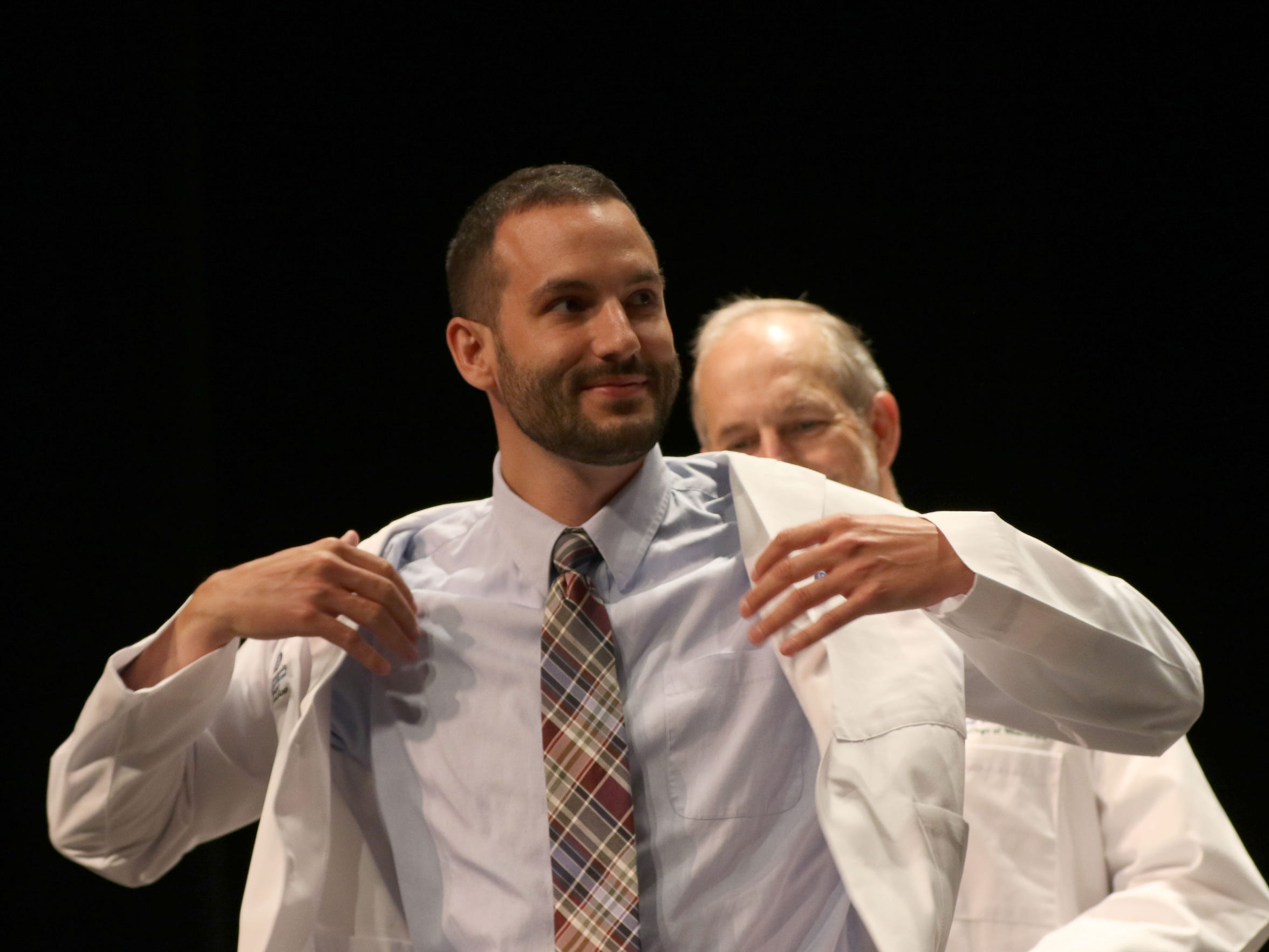 Neal Smith is coated during the Medical College of Wisconsin Central Wisconsin White Coat Ceremony at UW Marathon County, in Wausau, Wisconsin, July 7, 2016.