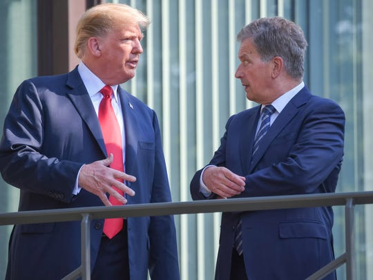 President of Finland Sauli Niinisto and President Donald Trump at the president's official residence in Mantyniemi, in Helsinki Monday.