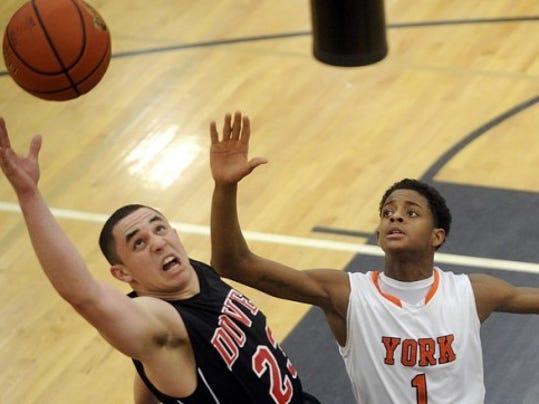 Dover's Connor Snyder and William Penn's Derek Wilson vie for a rebound Tuesday.