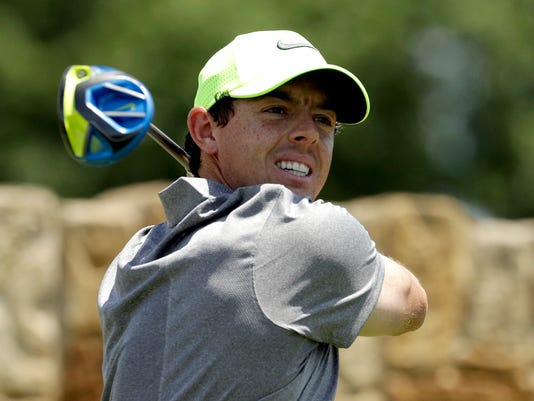 FILE - In this Saturday, June 18, 2016 file photo, Rory McIlroy, of Northern Ireland, watches his tee shot on the ninth hole during the rain delayed second round of the U.S. Open golf championship at Oakmont Country Club, in Oakmont, Pa. McIlroy says he will not be competing in the golf tournament at the Rio de Janiero Olympics because of concerns over the Zika virus, it was reported Wednesday, June 22, 2016. (AP Photo/Charlie Riedel, File)
