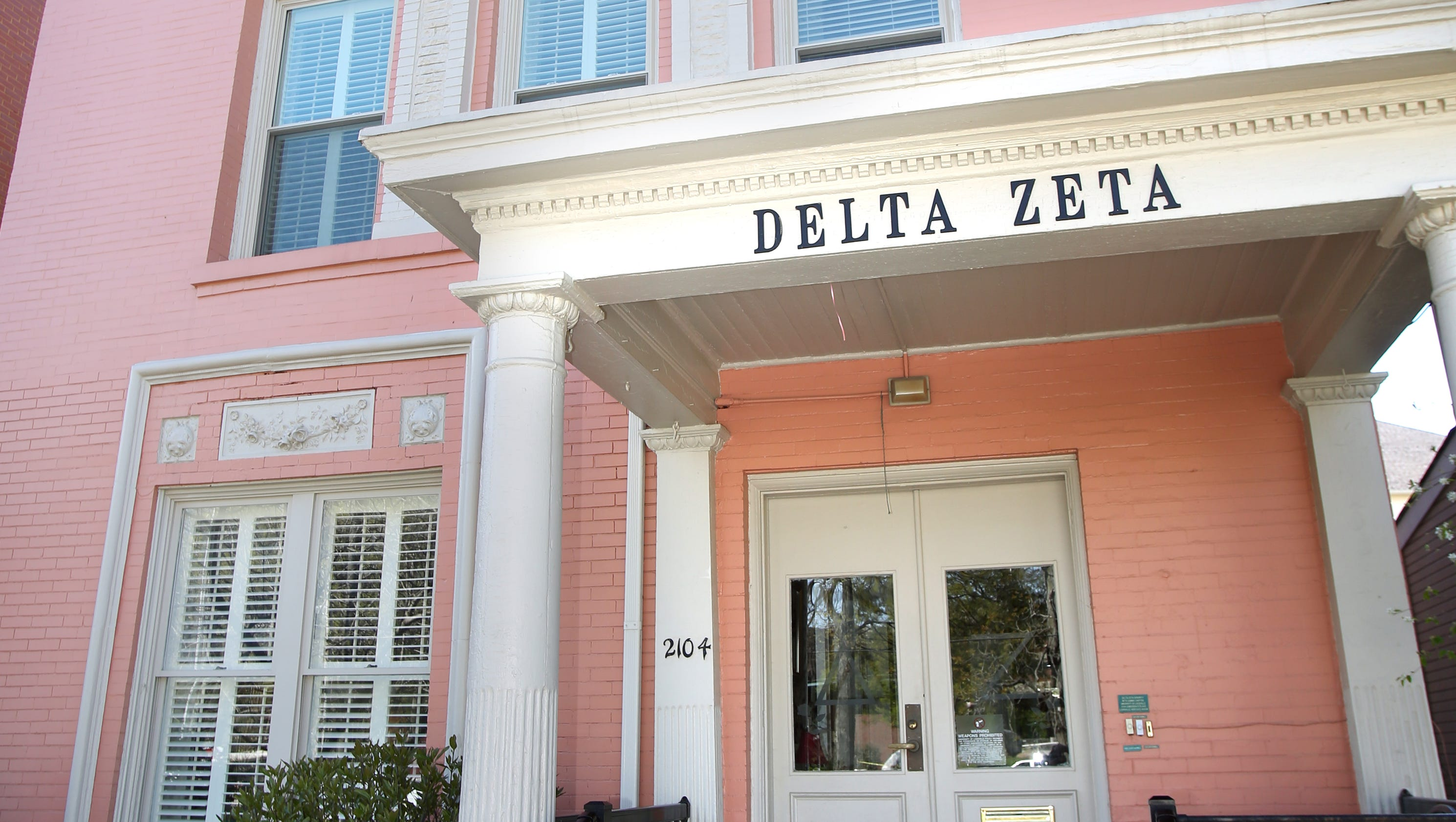 delta zeta house shines with pops of green pink home of the week