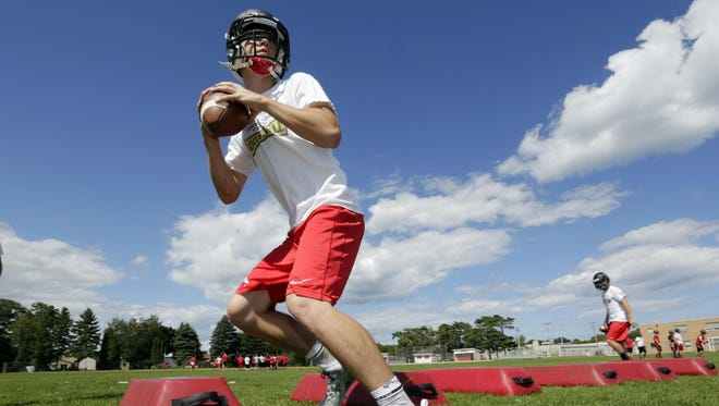 A Sheboygan South player prepares to pass the ball during practice on Aug. 4 in Sheboygan.