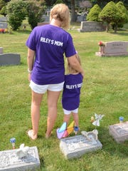 Katie Rohrhoff and daughter Payton wore their personalized Riley Katheryn Foundation T-shirts to the cemetery.