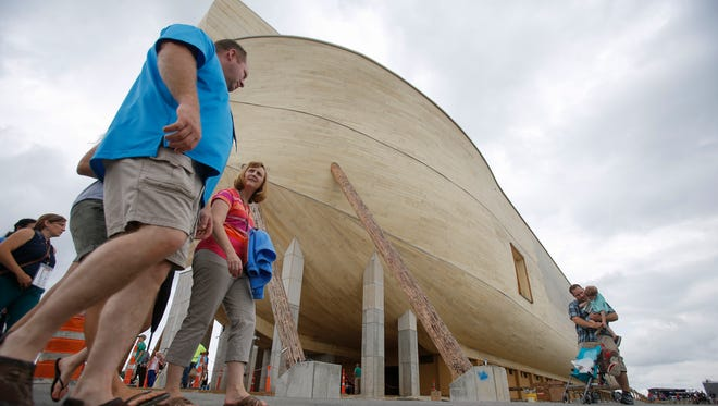 Visitors walk around the replica ark on July 5 at the Ark Encounter in Williamstown, Ky.