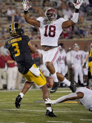 Tigers quarterback Shawn Robinson (3) throws a pass that is blocked by Alabama defensive lineman LaBryan Ray (18) during the first half at Faurot Field.