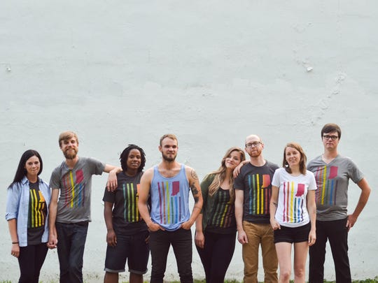 Models for United State of Indiana sport pro-LGBT Hoosier pride T-shirt designs. Graham Brown, second from left, founded the design company in 2012.