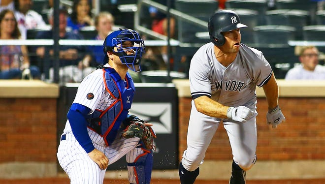 New York Yankees center fielder Brett Gardner (11) watches his two run home run against the New York Mets during the eighth inning at Citi Field.