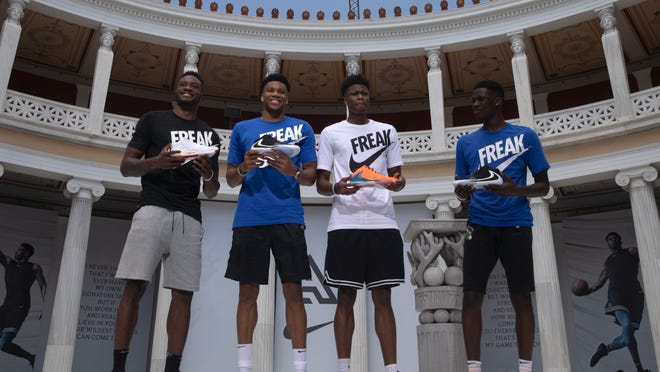 Basketball player Giannis Antetokounmpo (second left) of the Milwaukee Bucks, who was named NBA Most Valuable Player for 2018-'19, poses with his brothers Thanasis (from left), Kostas and Alex during the presentation of his new shoe in Zappeion Hall, Athens, June 28, 2019. Antetokounmpo is in Greece to attend a 3x3 baseball tournament which he sponsors. (AP Photo/Petros Giannakouris)