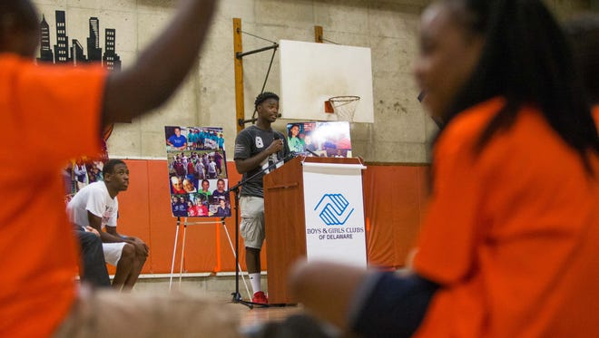 Kemuel Harding speaks to officials about the role after-school programs have played in his life following an announcement that more than $900,000 will go toward 16 organizations to provide summer and after-school programs for teens and youth.