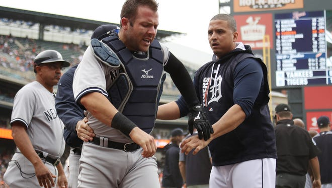Yankees catcher Austin Romine is held back by Tigers DH Victor Martinez during a bench clearing fight in the sixth inning of the Tigers' 10-6 win on Thursday, Aug. 24, 2017, at Comerica Park.