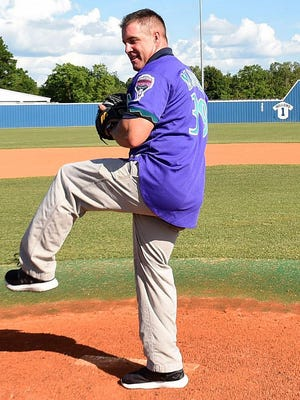 St. Edmund baseball coach Barry Manuel, shown here throwing out the first pitch at an American Legion game, will be watching but not coaching as his Jays open postseason play Thursday.