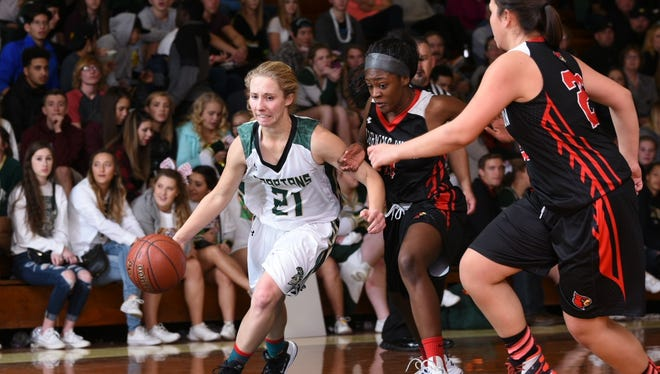 Red Bluff's Allyson Drury (left) dribbles around Corning defenders Elter Bright (center) and Nancy Salas (right) in their game Friday night at the Red Bluff Holiday Classic. Red Bluff won 62-36.