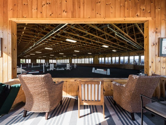 The equestrian center features a  heated and lighted 80-by-180-foot indoor ring with viewing area.