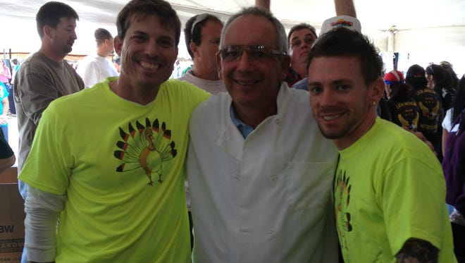Bob Leone (center) stands with two Thanksgiving volunteers. Leone has organized food production and serving at Mustard Seed Ministries' Thanksgiving Community Feast in Fort Pierce for the past 11 years.