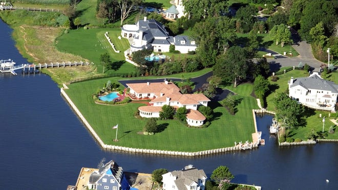 This Oyster Bay Drive mansion has a private peninsula and sits across from 22-acre Gunning Island.