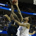 UK's Willie Cauley-Stein records one of three Cats blocks in the first half Thursday against West Virginia.