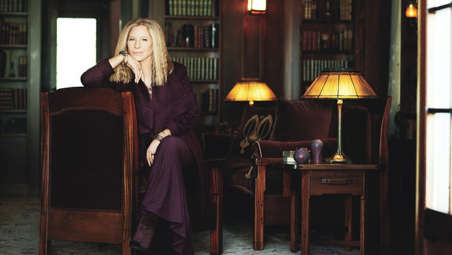 Barbra Streisand poses for 'Glamour' magazine in the library of her Malibu home.