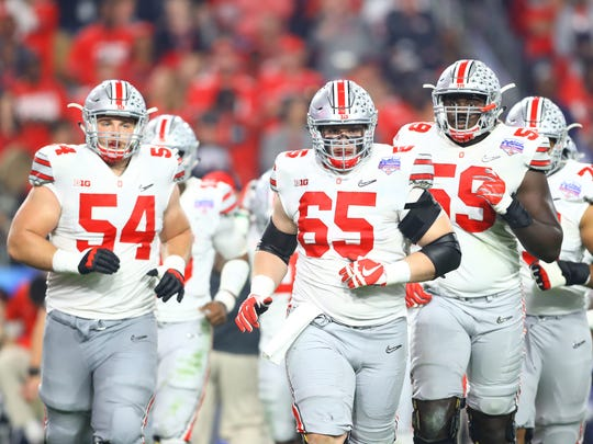 Billy Price (54) and Isaiah Prince (59) are two of the four returning starters on Ohio State 's offensive line.