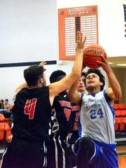 Carlsbad's Matt Rendon attacks the basket in a summer