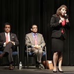 District attorney candidate Yvonne Rosales fields a question during a debate Thursday at Americas High School. Candidates Jaime Esparza, center, and Leonard Morales wait for their turns to speak.