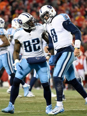 Titans tight end Delanie Walker (82) celebrates the touchdown with quarterback Marcus Mariota (8) during the second half at Arrowhead Stadium Saturday, Jan. 6, 2018 in Kansas City , Mo.