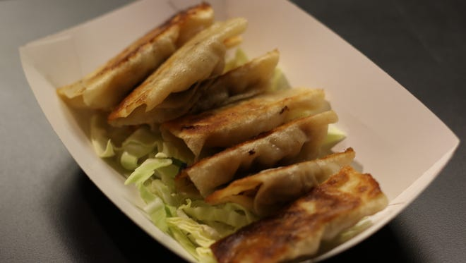 Potstickers at Yummy Dumpling in the basement of The Reed Opera House.