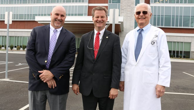 """From left, Gastrointestinal Associates CEO Jeff Dew, Knox County Mayor Tim Burchett and GIA founder Dr. Bergein """"Gene"""" Overholt celebrate the opening of the GIA's new Dowell Springs facility on March 20. The $15 million patient-centered facility is located in Dowell Springs Business Park and includes a GI clinic, Endoscopy Center, GIA 180 Weight Management Center and Crohn's and Colitis Institute."""