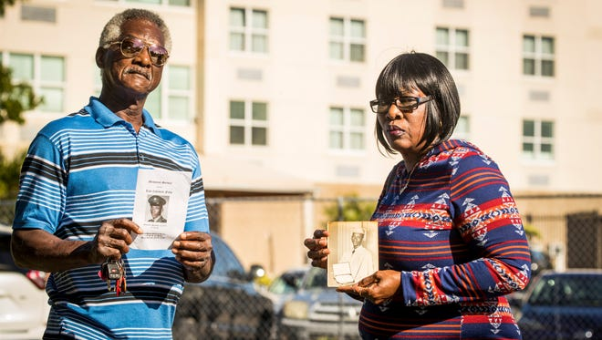 Larry and Toni McFarley hold photos of their brother Coleman Felts in front of the Golden Glades Nursing and Rehabilitation Center in Miami. Felts wandered from the nursing home in December 2015 and drowned in a lake.