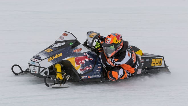 Shown letting it all hang out in a corner, Gunnar Sterne is the defending TLR Cup champion and current points leader as the United States Snowmobile Association brings the high-tech sleds to Luxemburg Speedway this weekend.