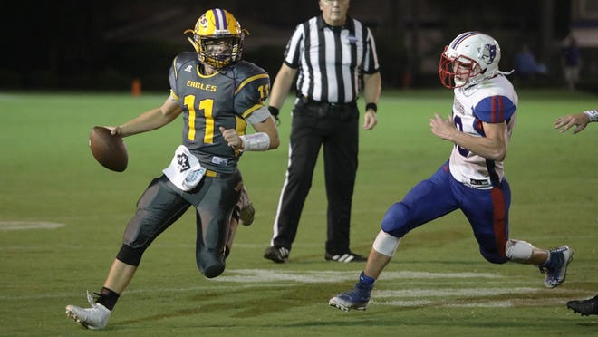 Athens Christian's Caleb Williams (11) runs during the Eagles' 20-6 win last Friday against Oglethorpe County.