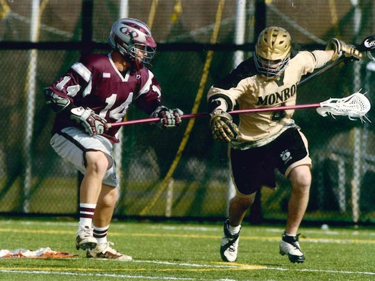 This 2006-2007 photo shows Nathan Smeltzer, left, playing lacrosse in college. Photo courtesy of Kerry and Sindy Smeltzer.