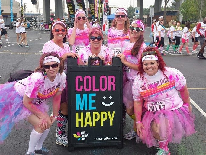 Automated Collection Services Inc. employees take part in The Color Run.