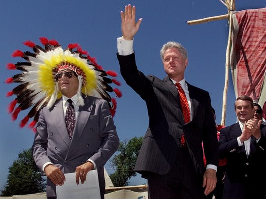 President Clinton waves as he takes the stage with Harold Salway, tribal president of the Oglala Sioux nation Wednesday on the Pine Ridge Indian Reservation. July 1999.