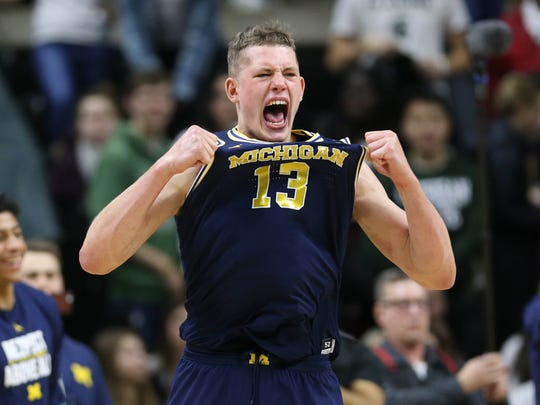Moritz Wagner celebrates after scoring a career-high 27 points in Michigan's 82-72 win over  Michigan State on Saturday, Jan. 13, 2018 at the Breslin Center in East Lansing.
