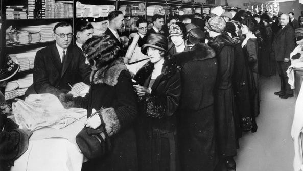 Women crowd the counters of one of the first Sears