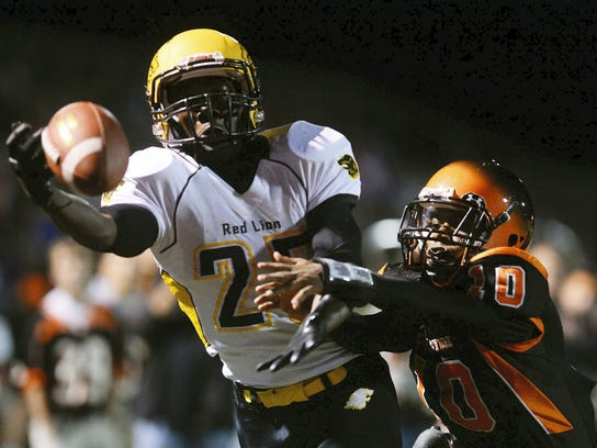 """Central York's Rodney Johnson defends Red Lion's Pat Stafford as he strains for a ball that's just out of reach in the end zone last year at Central York. Even in a six-classification format Central and Red Lion would still play in 6A with the state's largest schools. A """"Super 700"""" would be required for both schools to play 5A. (FILE -- GAMETIMEPA.COM)"""