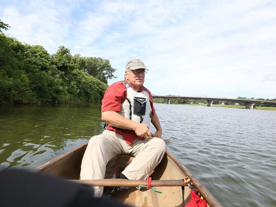 Chemung River Friend Don Hall guides his canoe on the