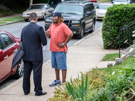 New Castle County executive candidate Matt Meyer (left) talks with Deven Fowles in the Triangle neighborhood of Wilmington on June 27. He is looking to unseat longtime New Castle County figure Thomas P. Gordon.