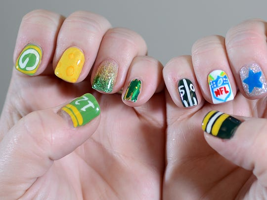 Patti Wagnitz, of Creative Hair Design, has her nails with Packers game day colors.