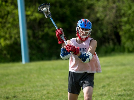 Chris Koehler, 17, takes a shot during lacrosse practice Wednesday, May 17, 2017 at Eddy Elementary School in St. Clair.