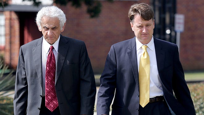 """Contractor S.H. """"Sean"""" Anthony, right, charged with conspiracy in the bribery of the former Harrison County Utility Authority director and a board member, arrives at the federal courthouse in Gulfport, Miss., for his initial hearing with attorney Joe Sam Owen on Tuesday, March 3, 2015. Anthony waived indictment in the case and agreed to prosecution by a bill of information. However, Owen said Anthony plans to enter a guilty plea before a district judge at a later date."""