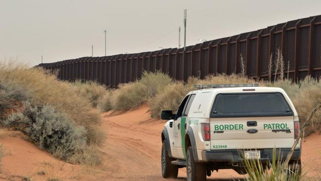 FILE - In this Jan. 4, 2016 file photo, a U.S. Border Patrol agent drives near the U.S.-Mexico border fence in Santa Teresa, N.M. (AP Photo/Russell Contreras, File)
