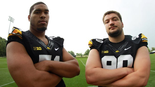 Iowa defensive linemen Carl Davis, left, and Louis Trinca-Pasat pose for a photo during Iowa football media day on Monday, Aug. 4, 2014.