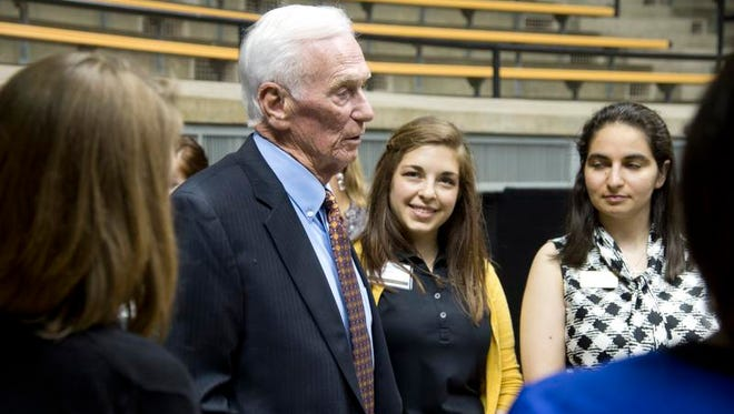 Gene Cernan greets students at a reception in Mackey Arena   during last week's astro- nauts reunion.