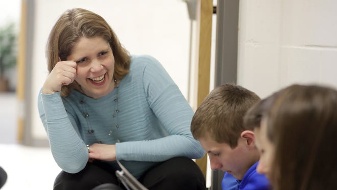 Golden Apple winner Adrianne Burns, a math teacher at De Pere Middle School, works with her students Wednesday, March 23, 2017.