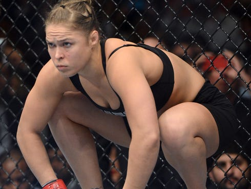 Ronda Rousey  stares at her opponent, Miesha Tate, during their UFC 168 bantamweight title fight Saturday at MGM Grand Garden Arena. Rousey remained undefeated.