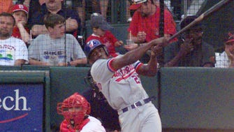 Montreal Expos' Vladimir Guerrero bats in the first inning against the St. Louis Cardinals at Busch Stadium in St. Louis, Monday, June 14, 1999. The Guerrero brothers were a combined  6 for 8 with three RBI's and four runs scored. Cardinals catcher is Eli Marrero.
