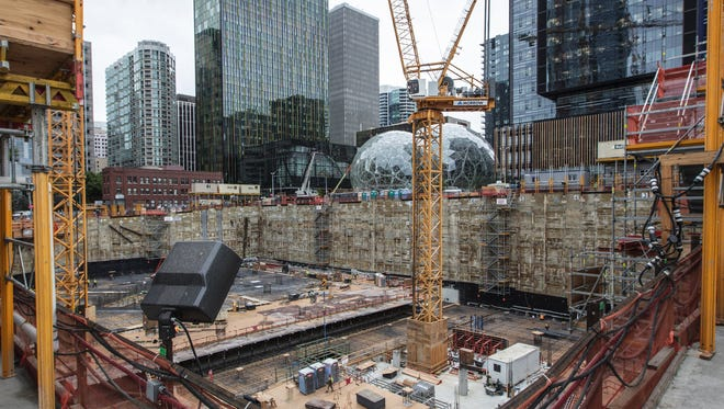 An Amazon building is being built near its Doppler building (left) and its Spheres and Day 1 building (right) in downtown Seattle.